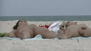 Very horny milf rubbing tits in nude beach