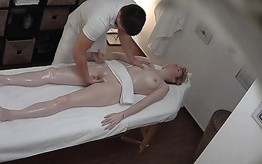 Beautiful Young Girl Spreding her Lengs unaffected by Massage Table