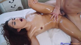 Curly haired cutie fucked by kinky guy during a massage