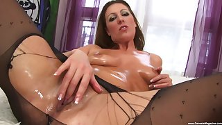 Vibrant MaryBeth uses a dildo close by please her shaved and wet pussy