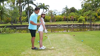 Golf tutor teaches amateur Shae Celestine how to handle a shaft