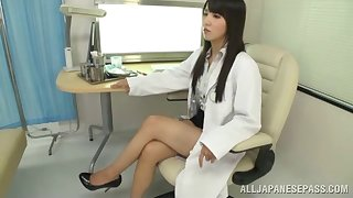 Long haired Asian doctor gives her patient special pharmaceutical