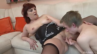 Mature slut Erovia in stockings givesa blowjob before having sex