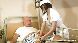 Teen nurse in glasses Adelle Sabelle gives a first-class blowjob to pensioner