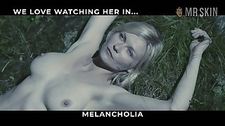 Hollywood star Kirsten Dunst flashing say no to big gut while lying on rub-down the grass