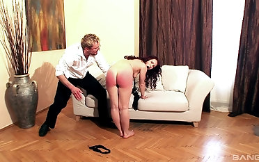 Kinky guy punishes sweet Olga Cabaeva by spanking her butt